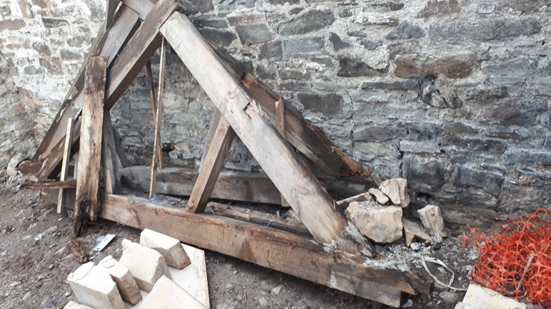 Rotten roof trusses.