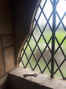 The restored window, with the original door key.